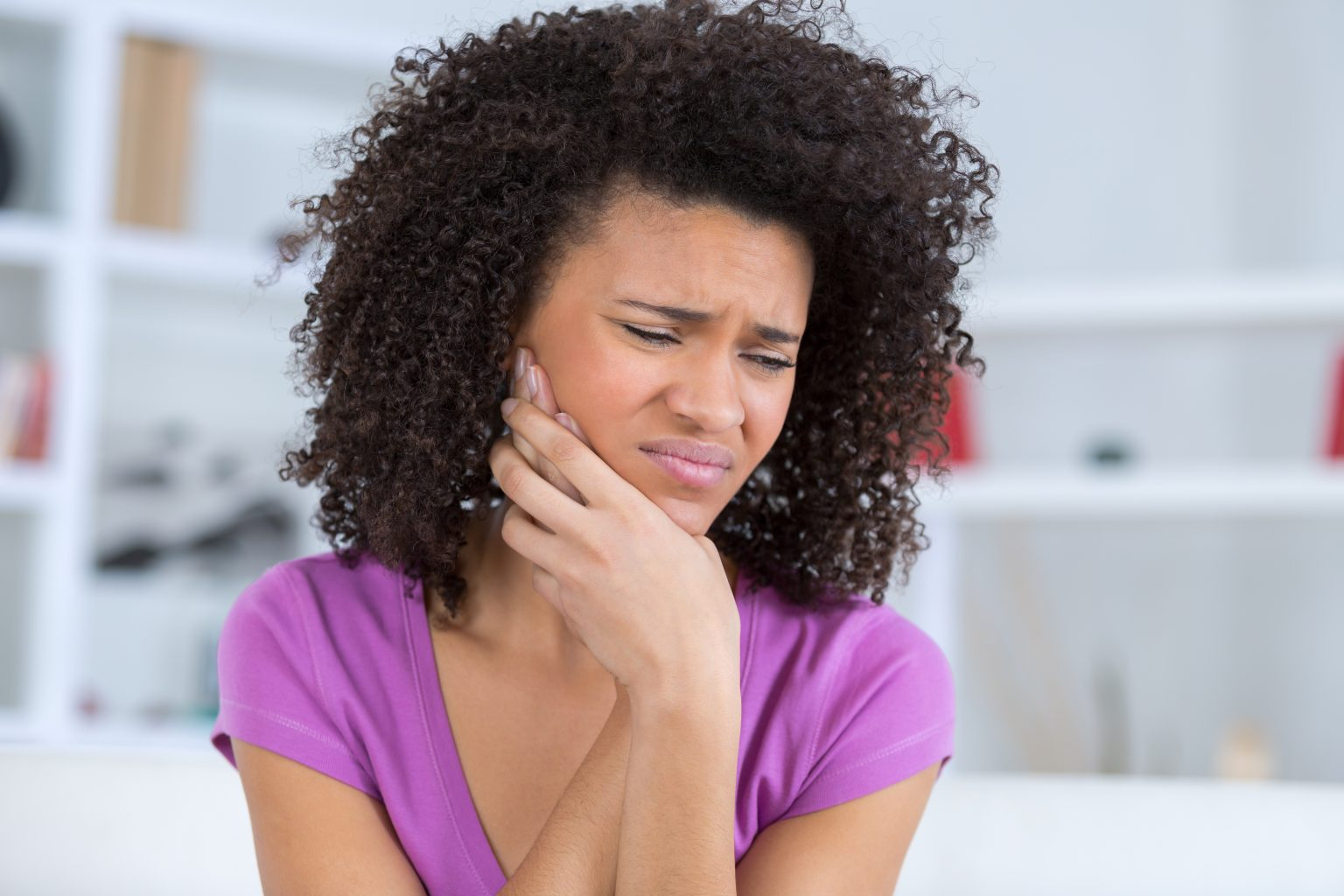 Pretty African American Young Woman Have A Toothache
