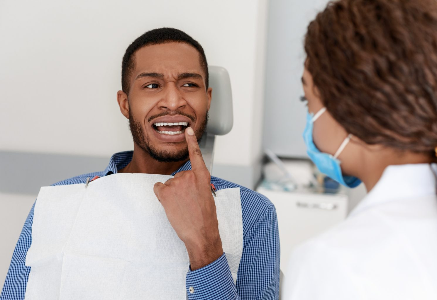 Black Guy Visiting Dentist, Showing Doctor Painful Teeth